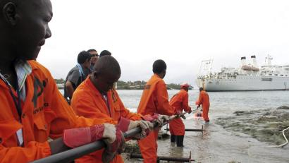 Contractors lay the East African Marine Cable (TEAMS) fiber optic cable from a ship in the Kenyan coastal city of Mombasa in 2009.