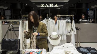 A woman browses for clothes inside a Zara store in Hong Kong