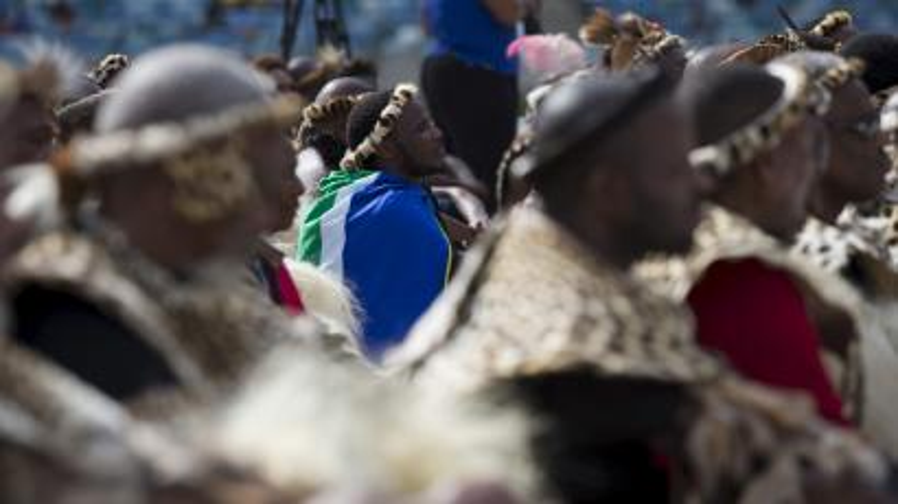 A Zulu elder wearing a South African flag listens to Zulu King Goodwill Zwelithini speak in Durban in 2015.