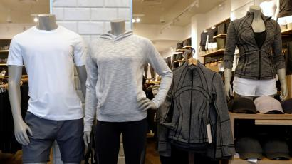 Clothes are displayed in a Lululemon Athletica retail store