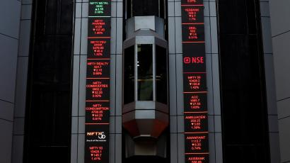 An elevator travels next to electronic boards displaying stock figures at the National Stock Exchange (NSE) building in Mumbai