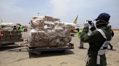 A gendarm takes photographs of a shipment of Covid-19 medical supplies donated by Jack Ma and the Alibaba Foundation, after it arrived in Senegal from Ethiopia, March 2020.