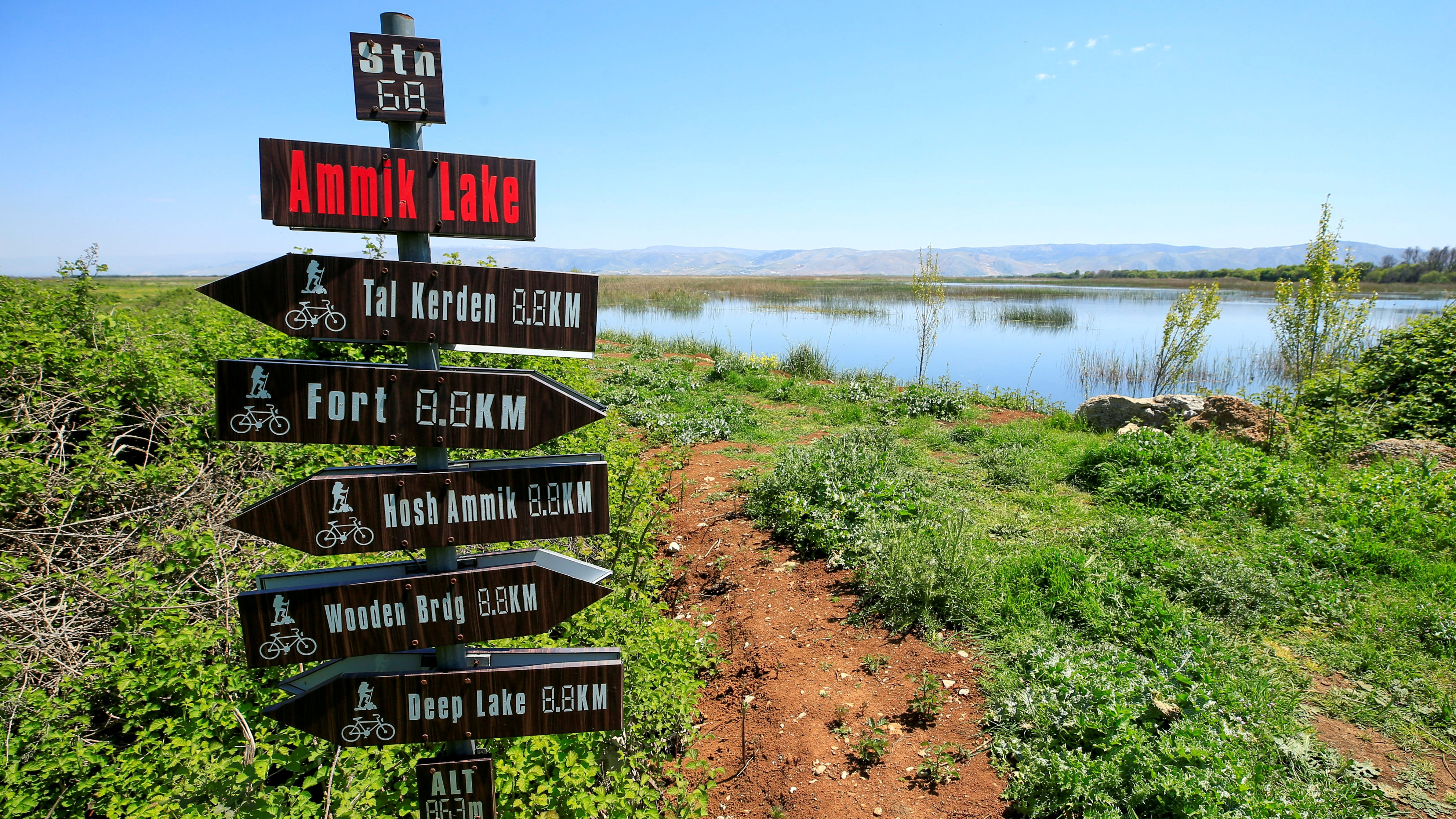Directional signs are seen in Ammiq Wetland