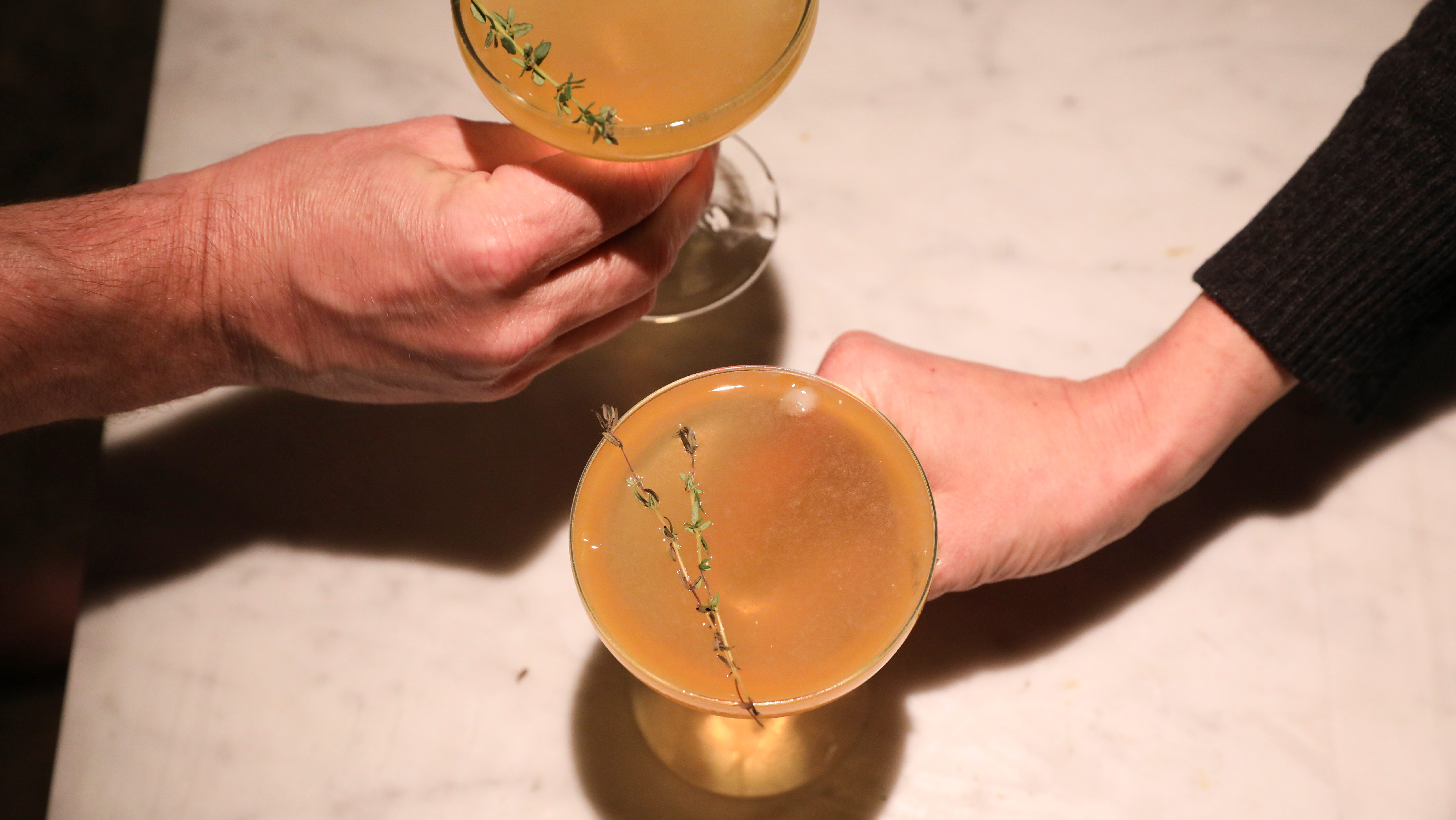 an overhead shot of two drinks that look like cocktails.