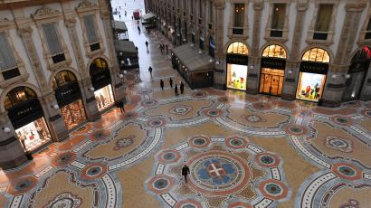 Closed shops are pictured in an almost deserted Galleria Vittorio Emanuele II in Milan