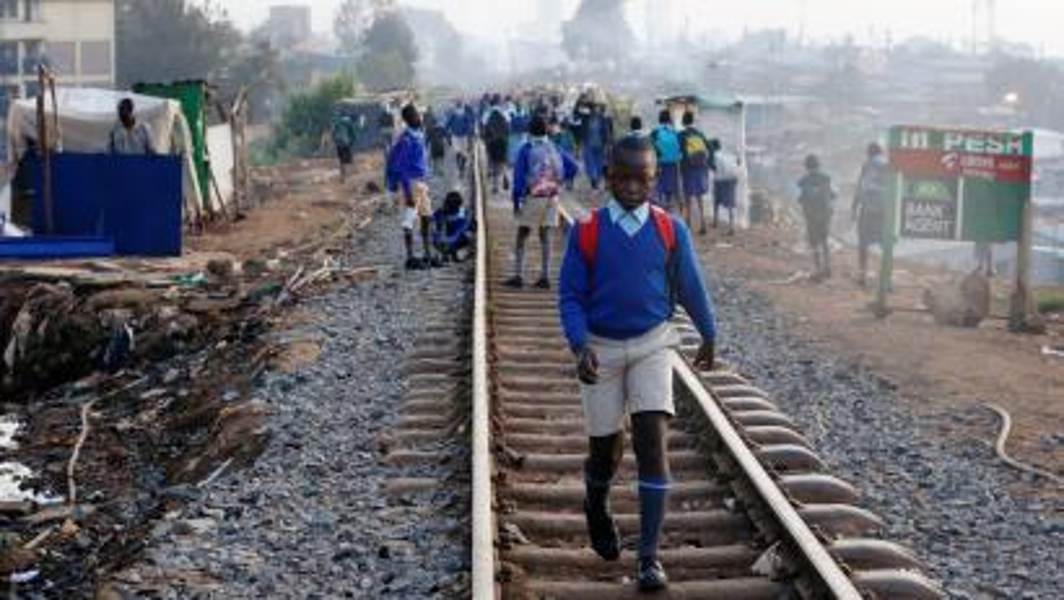 A schoolboy walks along the Kenya-Uganda railway line in January.