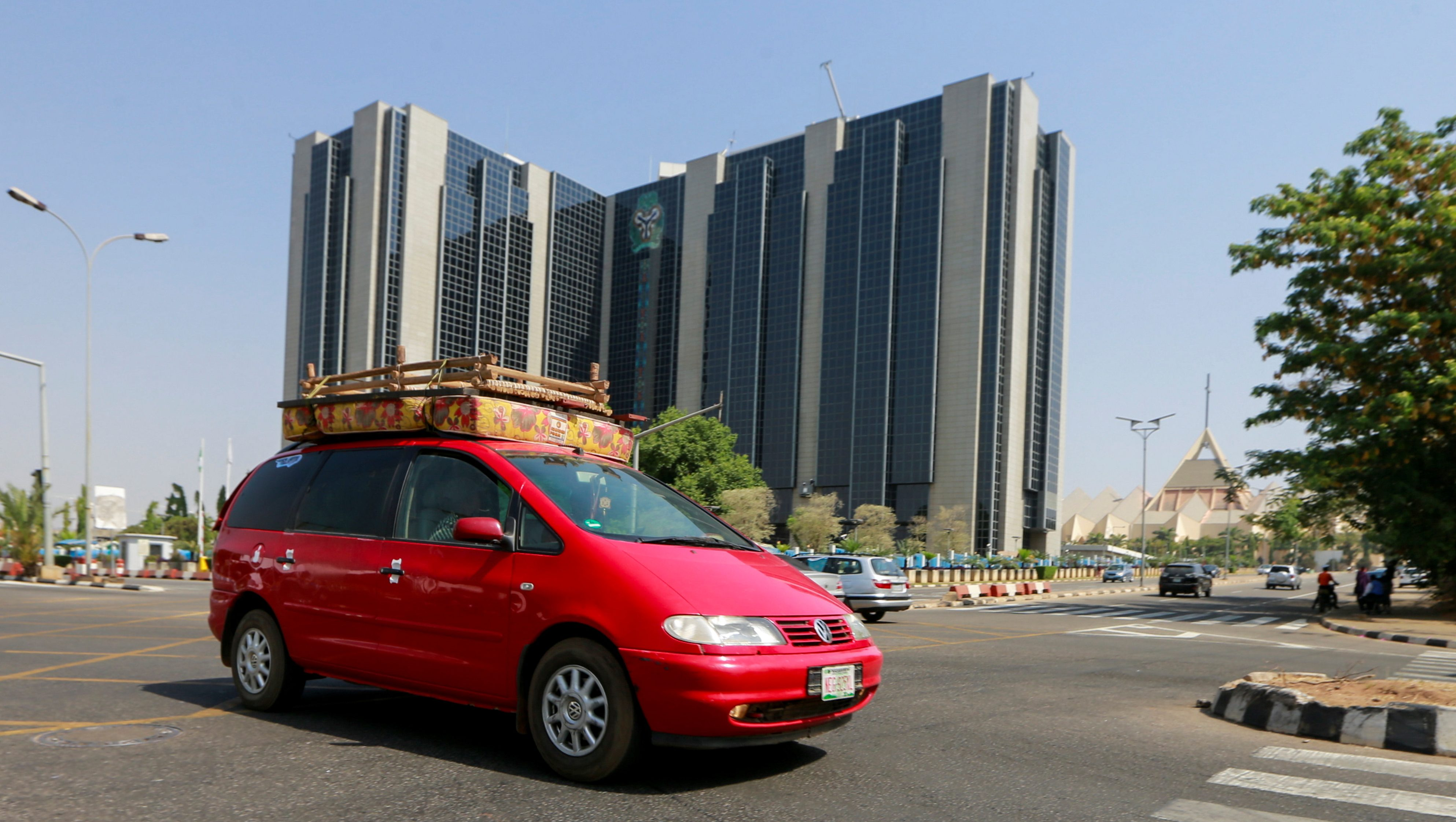 A car passes by the Central Bank headquarters in Abuja, Nigeria January 26.