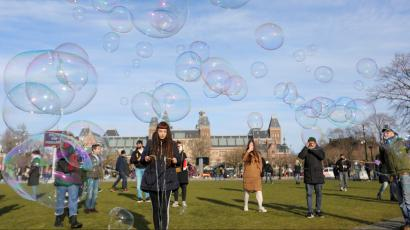 People make soap bubbles during a protest against restrictions put in place to curb the spread of the coronavirus disease (COVID-19), in Amsterdam, Netherlands