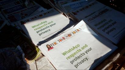 FILE PHOTO: A WhatsApp advertisement is seen on the front pages of newspapers at a stall in Mumbai