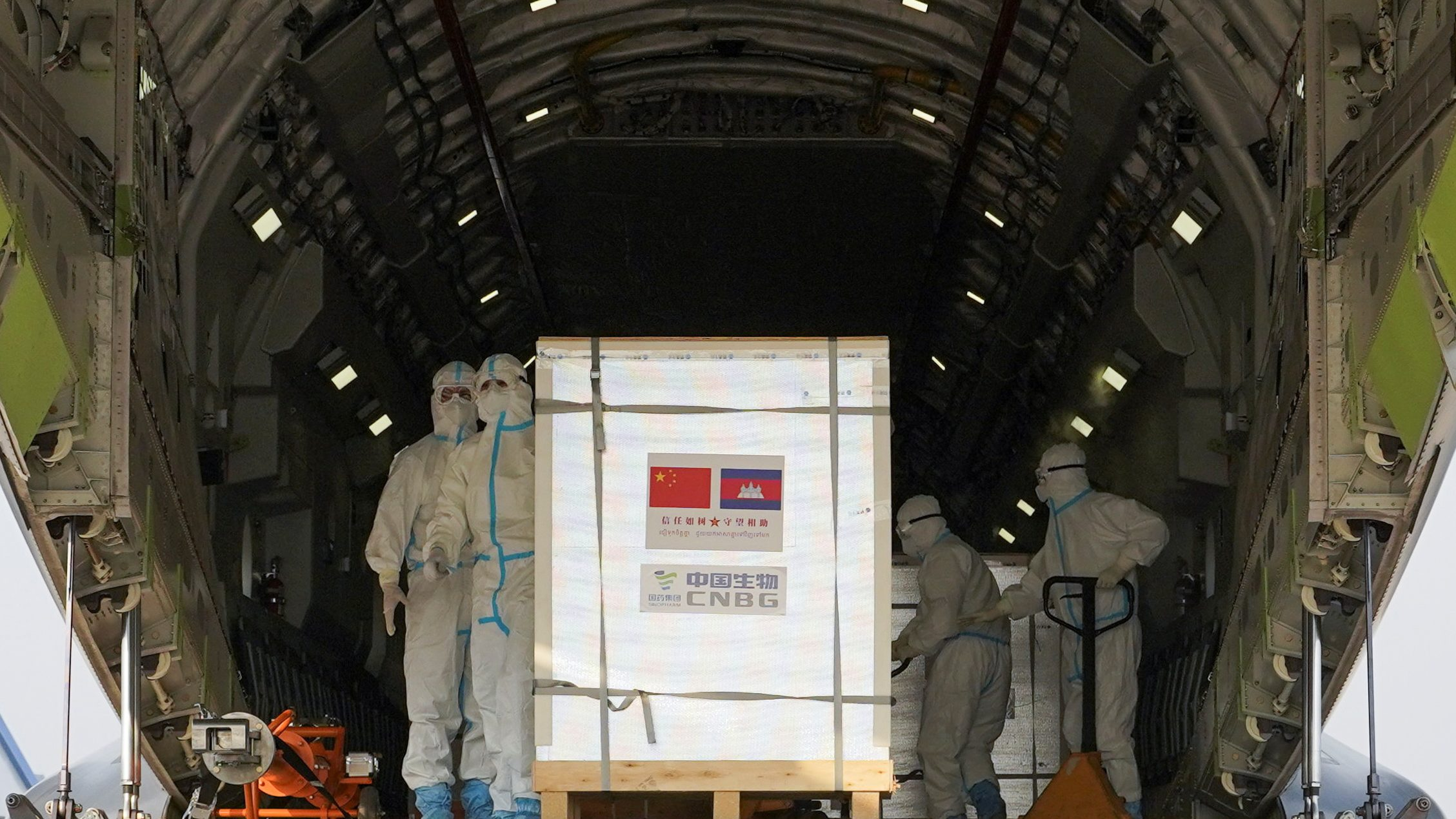 A shipment of 600,000 doses of COVID-19 vaccines donated by China arrives at the Phnom Penh International Airport