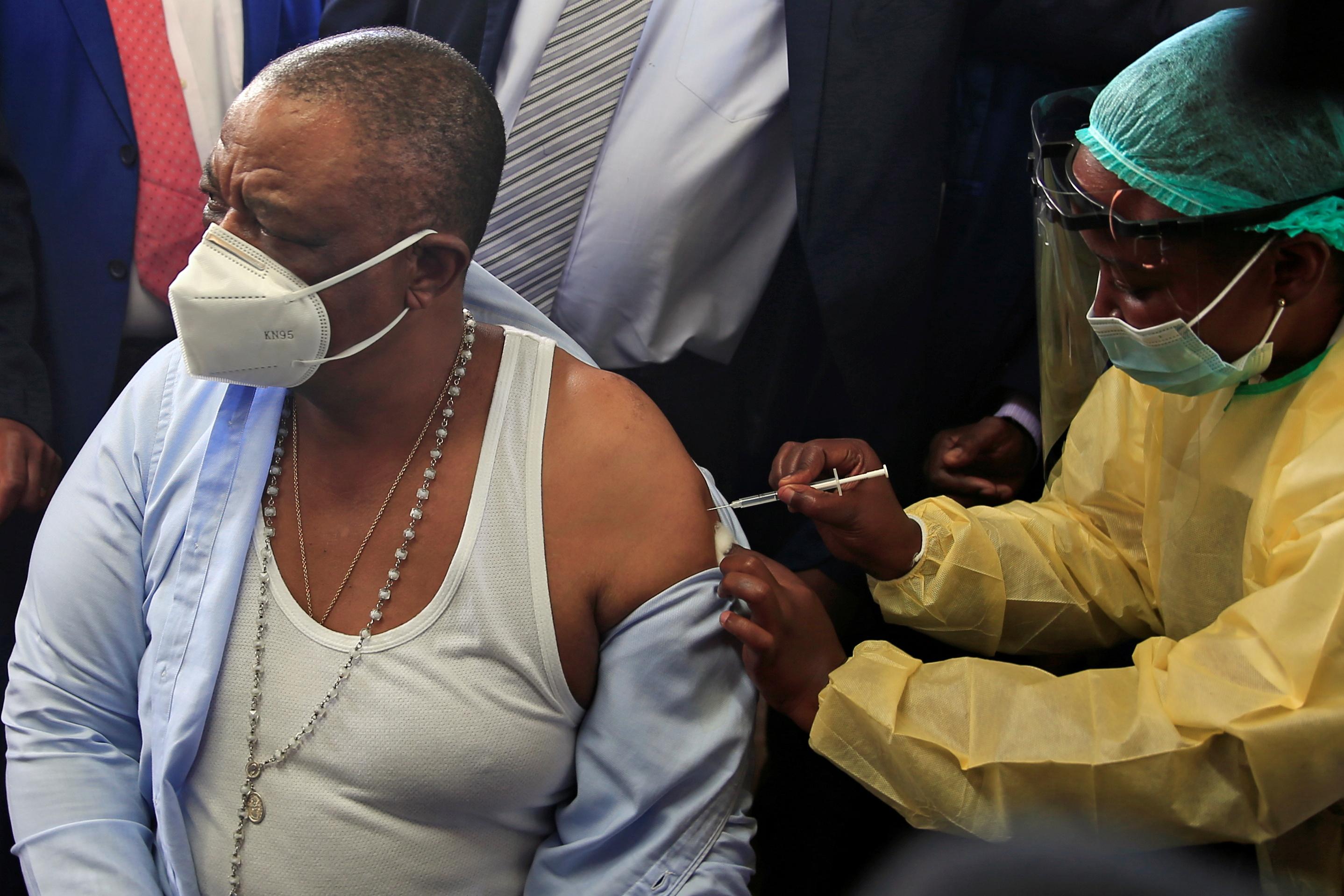 Zimbabwean Vice President Constantino Chiwenga receives Covid-19 vaccine.