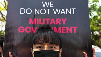 A woman takes part in a protest against the military coup at the University of Yangon, in Yangon, Myanmar, February 25, 2021