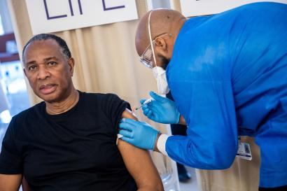 Rev. Jacques DeGraff receives a dose of the Pfizer-BioNTech vaccine against the coronavirus disease (COVID-19), at NYC Health + Hospitals Harlem Hospital in the Manhattan borough of New York City, New York, U.S., February 25, 2021.