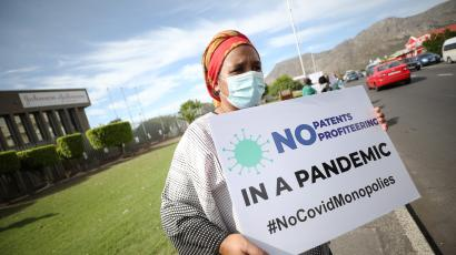 A woman holds a placard during a protest against Covid-19 vaccination distribution inequality outside the Johnson and Johnson offices in Cape Town earlier this month.