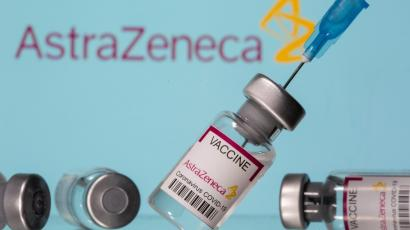 A stock image of a vaccine in front of the AstraZeneca logo