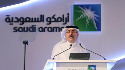 Aramco CEO Amin Nasser speaks from a podium during a news conference.