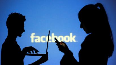The Facebook logo appears behind silhouettes of people using a laptop and smartphone.