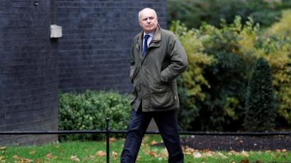 Iain Duncan Smith walks outside Downing Street in London