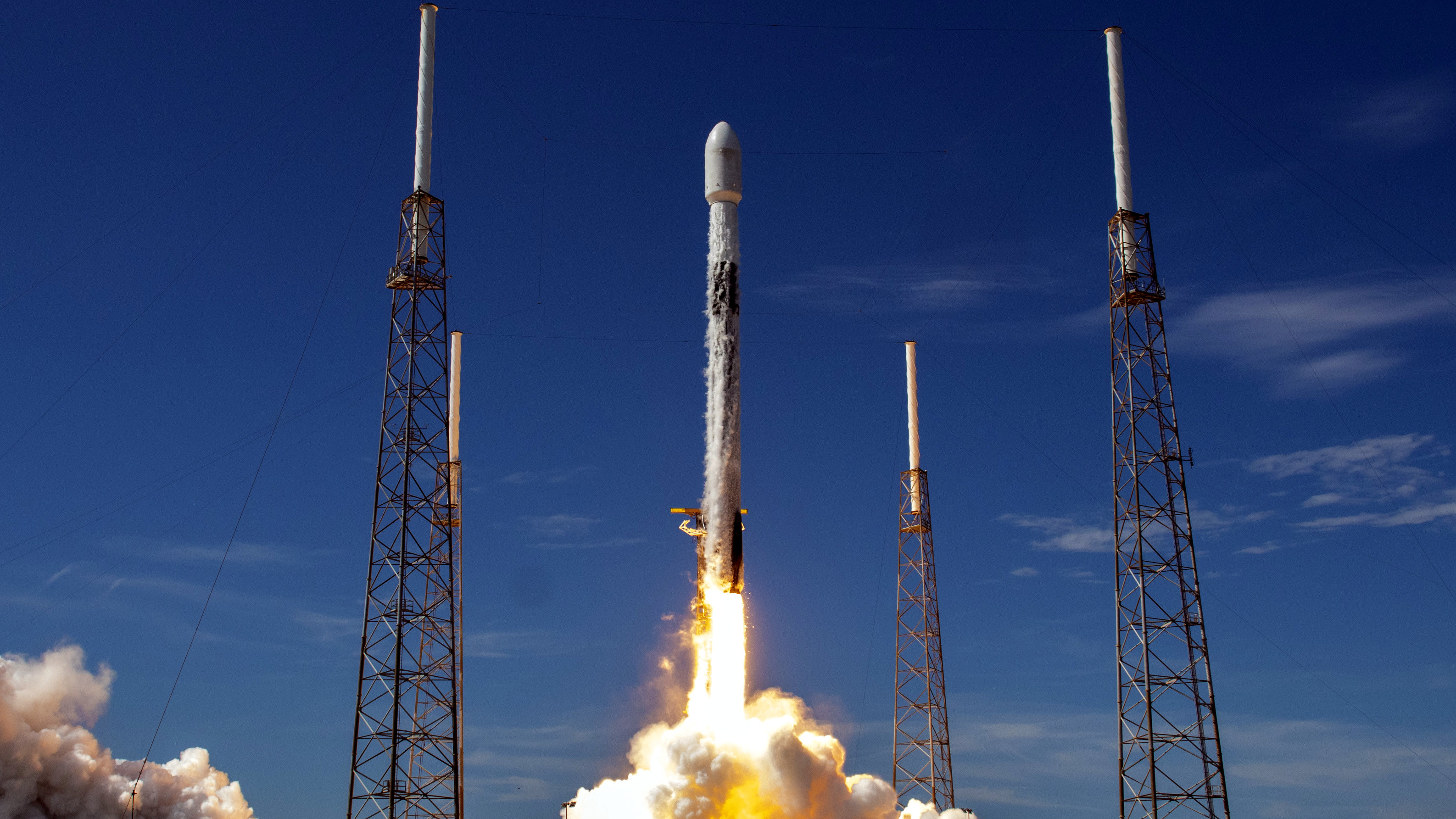 A SpaceX Falcon 9 rocket launches Starlink satellites in August 2020.