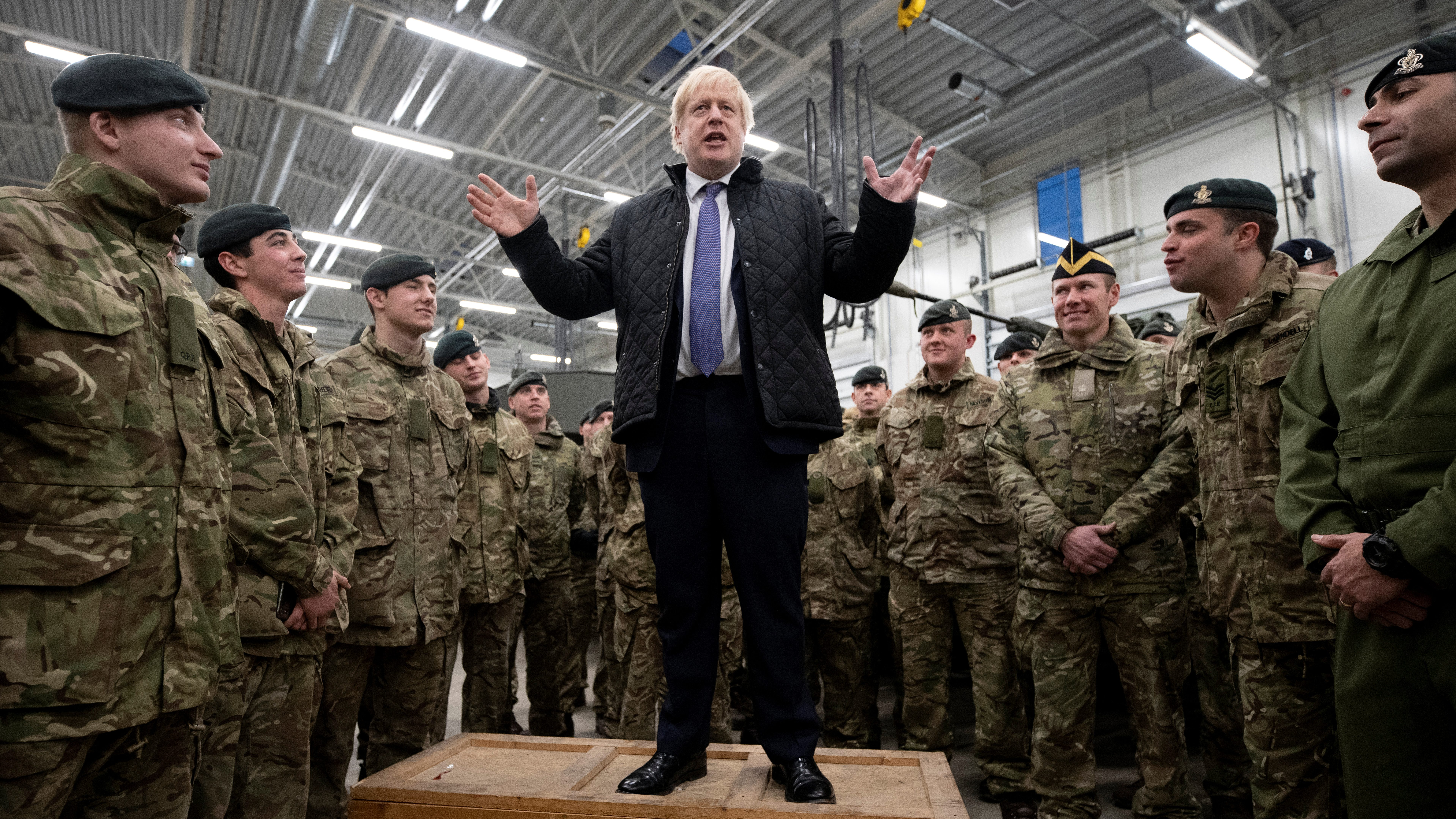 Prime minister Boris Johnson speaks during a visit to British troops stationed in Estonia