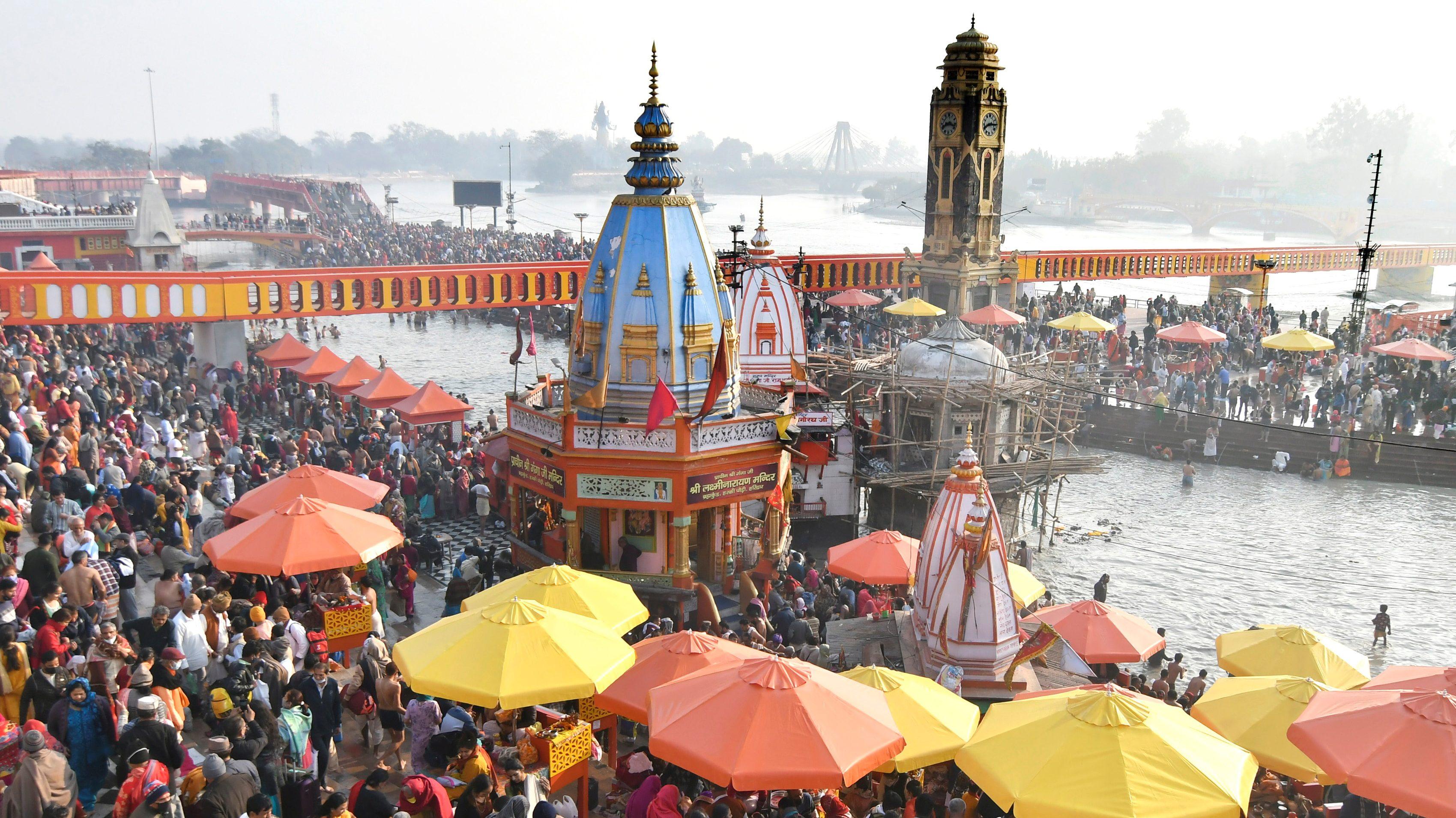 Hindu devotees gather to take a holy dip during religious Kumbh Mela in Haridwar