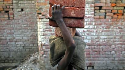 A child labourer carries bricks in Bihar-e-Sharif town, about 60 km (37 miles) from Patna.