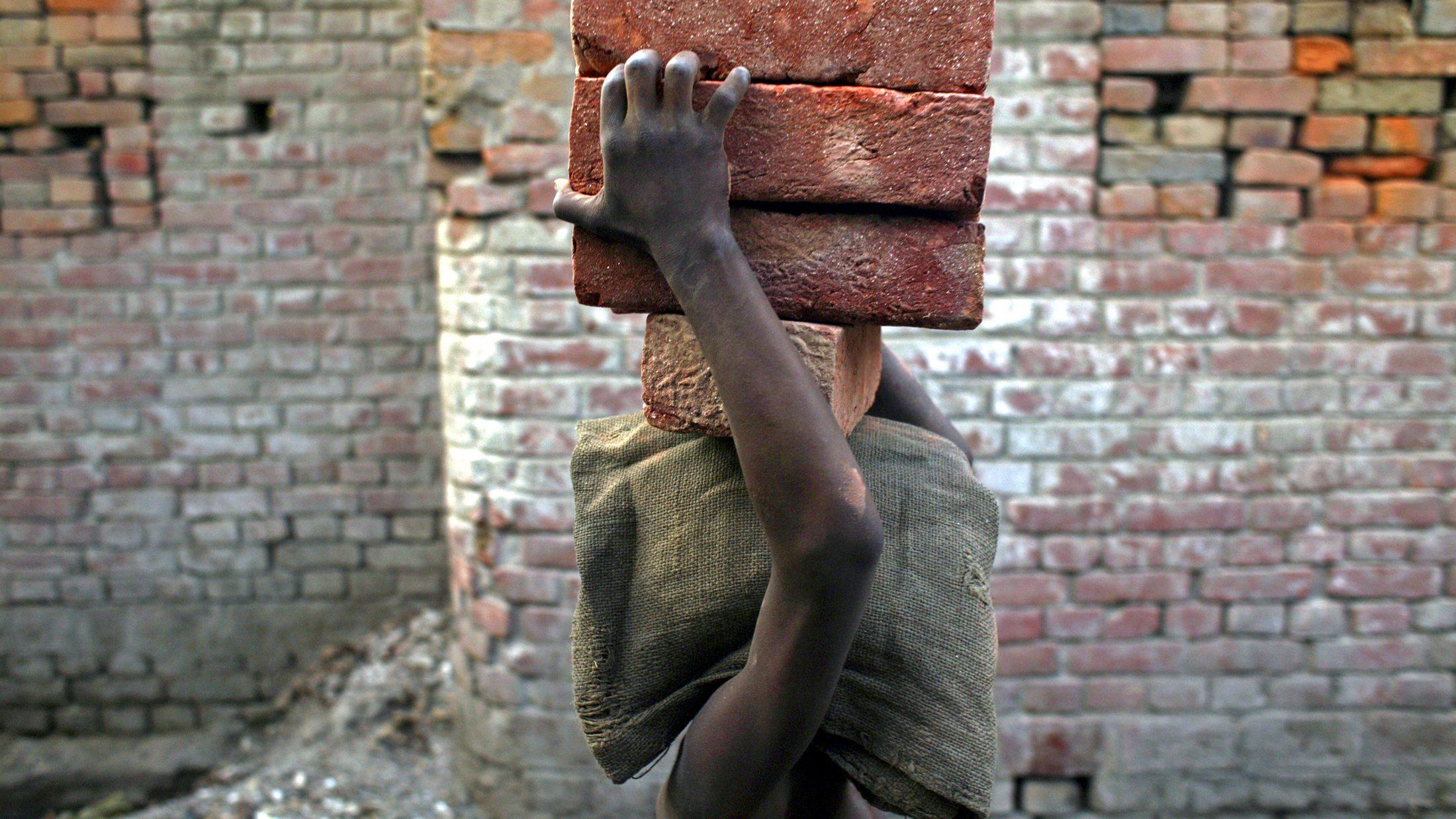 A child labourer carries bricks in Bihar-e-Sharif town, about 60 km (37 miles) from Patna.