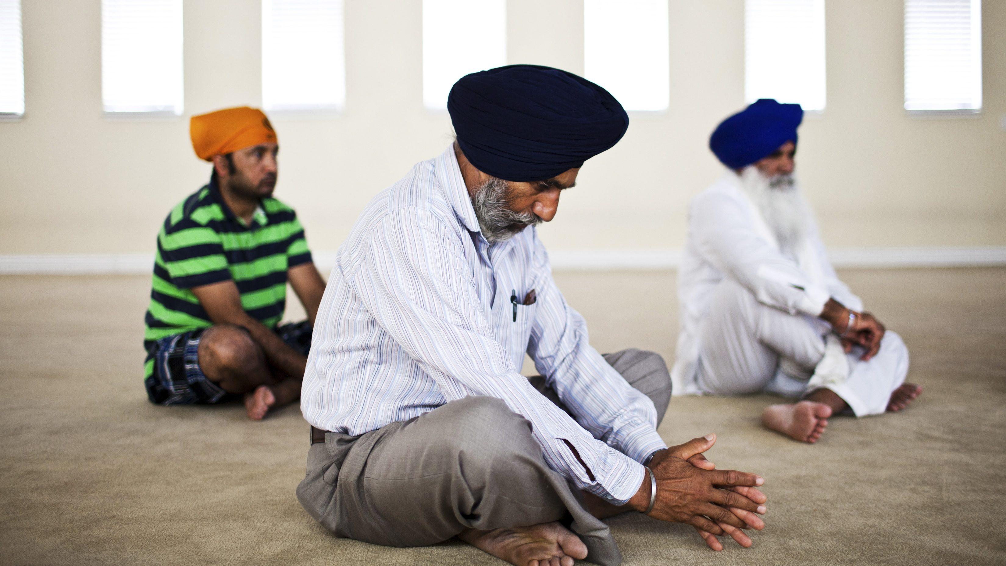 Randhir Singh prays at the Sikh Temple Gurdwara Sri Sachkand Sahib in Roseville, California