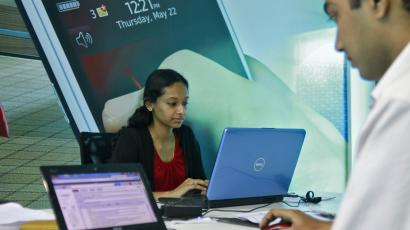Employees work on their laptops at the Start-up Village in Kinfra High Tech Park in Kochi