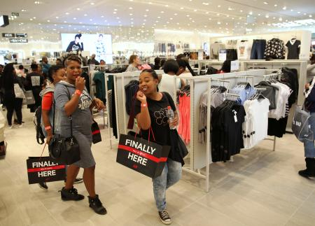 Shoppers react during the opening of the 'Mall of Africa' in Midrand outside Johannesburg, South Africa in 2016.