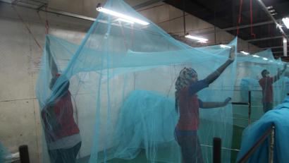 Workers look for holes in mosquito netting at the A to Z Textile Mills factory producing insecticide-treated bednets in Arusha, Tanzania, 2016.