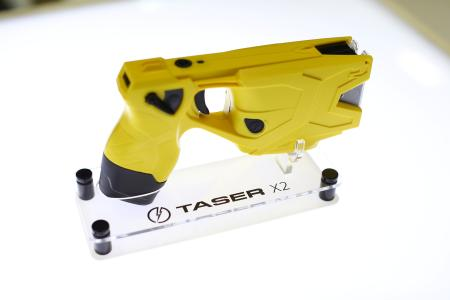 Photo of an X2 Taser gun is shown on display in the Taser booth at the International Association of Chiefs of Police conference in San Diego