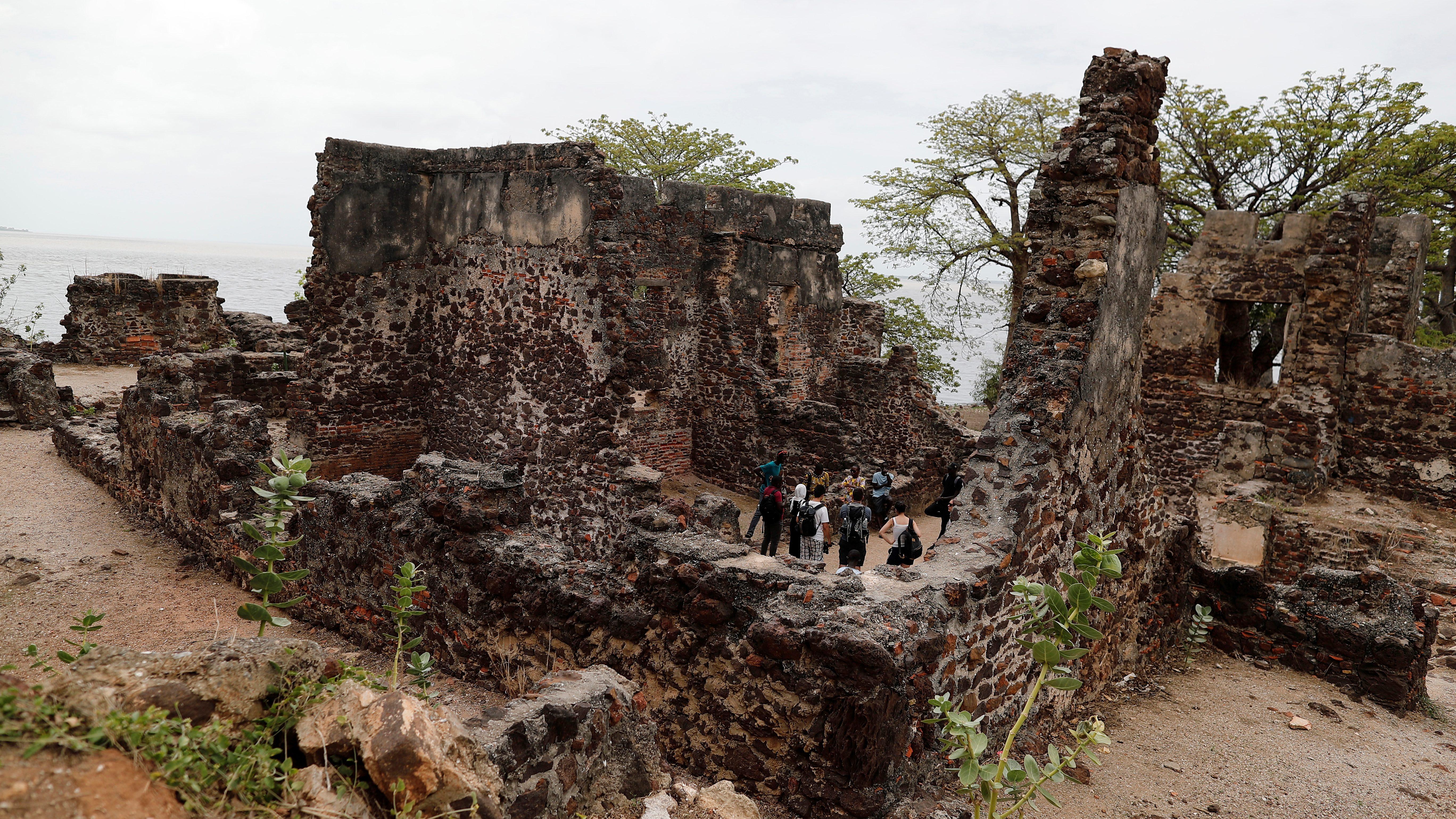 Tourists visit the ruins of Kunta Kinte island in the Gambia River, near Jufureh, Albreda