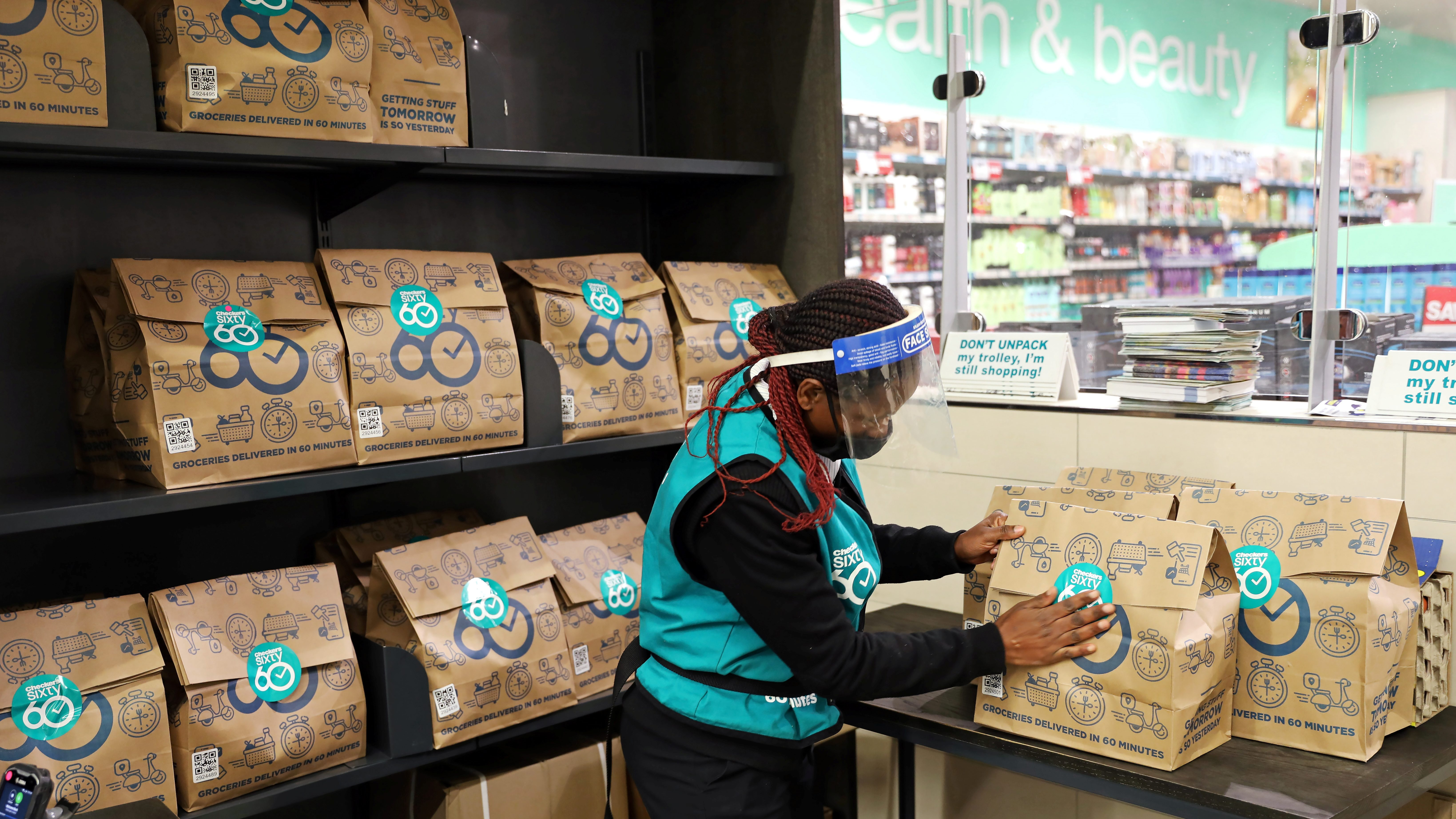 A worker sorts online orders before they are delivered to customers from a Checkers store, amid a nationwide coronavirus lockdown, in Johannesburg, South Africa, July 14, 2020.