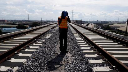A worker adjusts his hard hat at the National Arts Theatre stop of the light rail system under construction in Lagos, Nigeria, May 30, 2014.