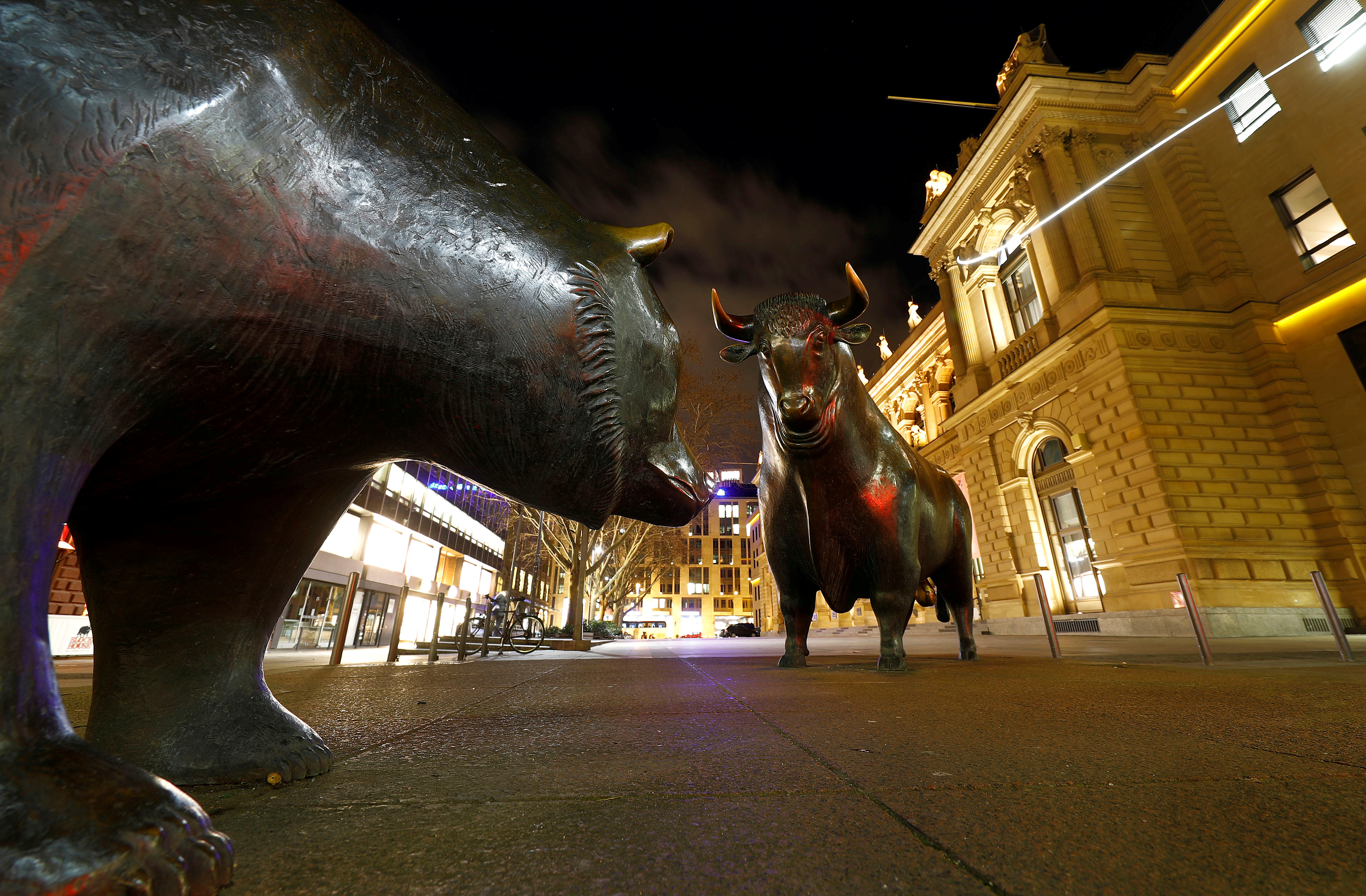 Bull and bear symbols for successful and bad trading are seen in front of the German stock exchange