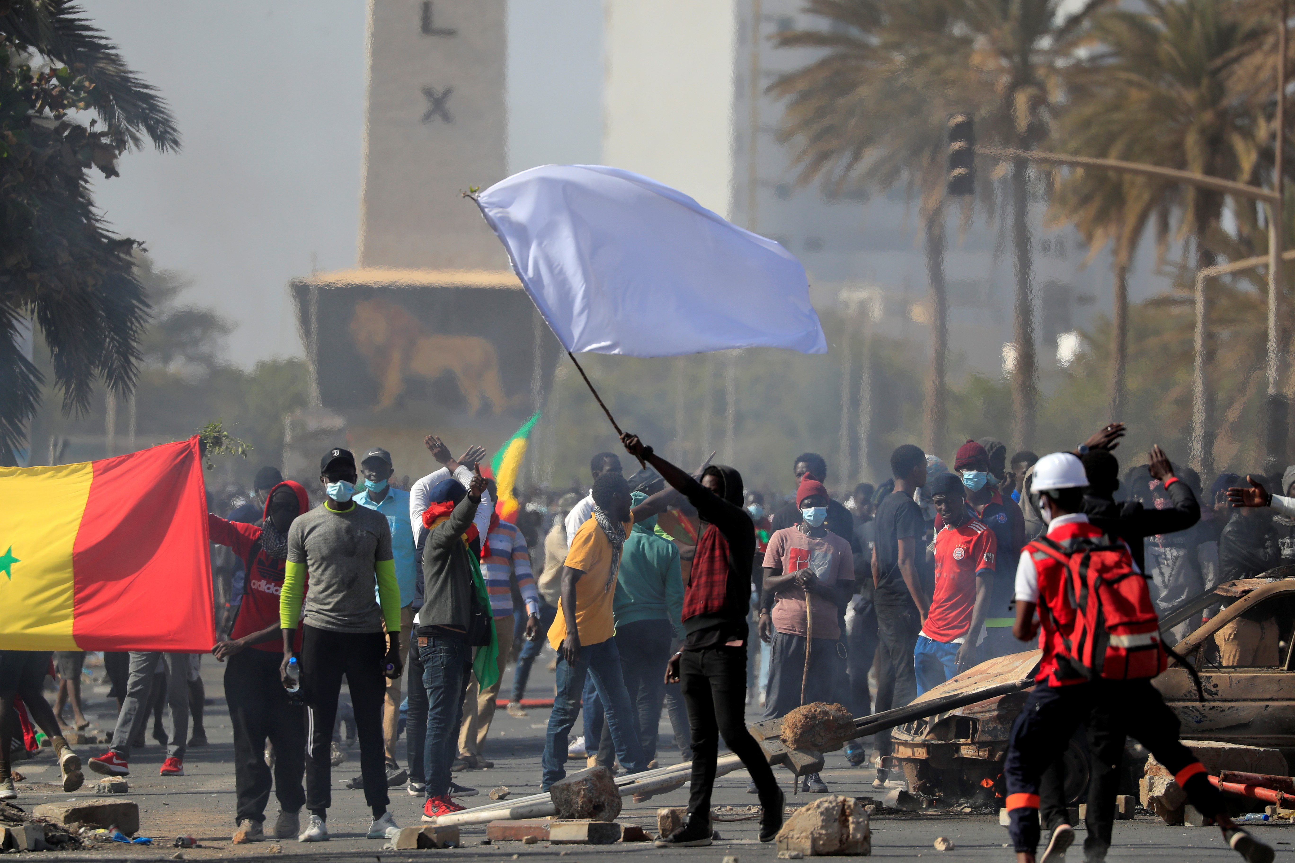 A supporter of opposition leader Ousmane Sonko holds a white flag during clashes with security forces in Dakar, Senegal March 8.