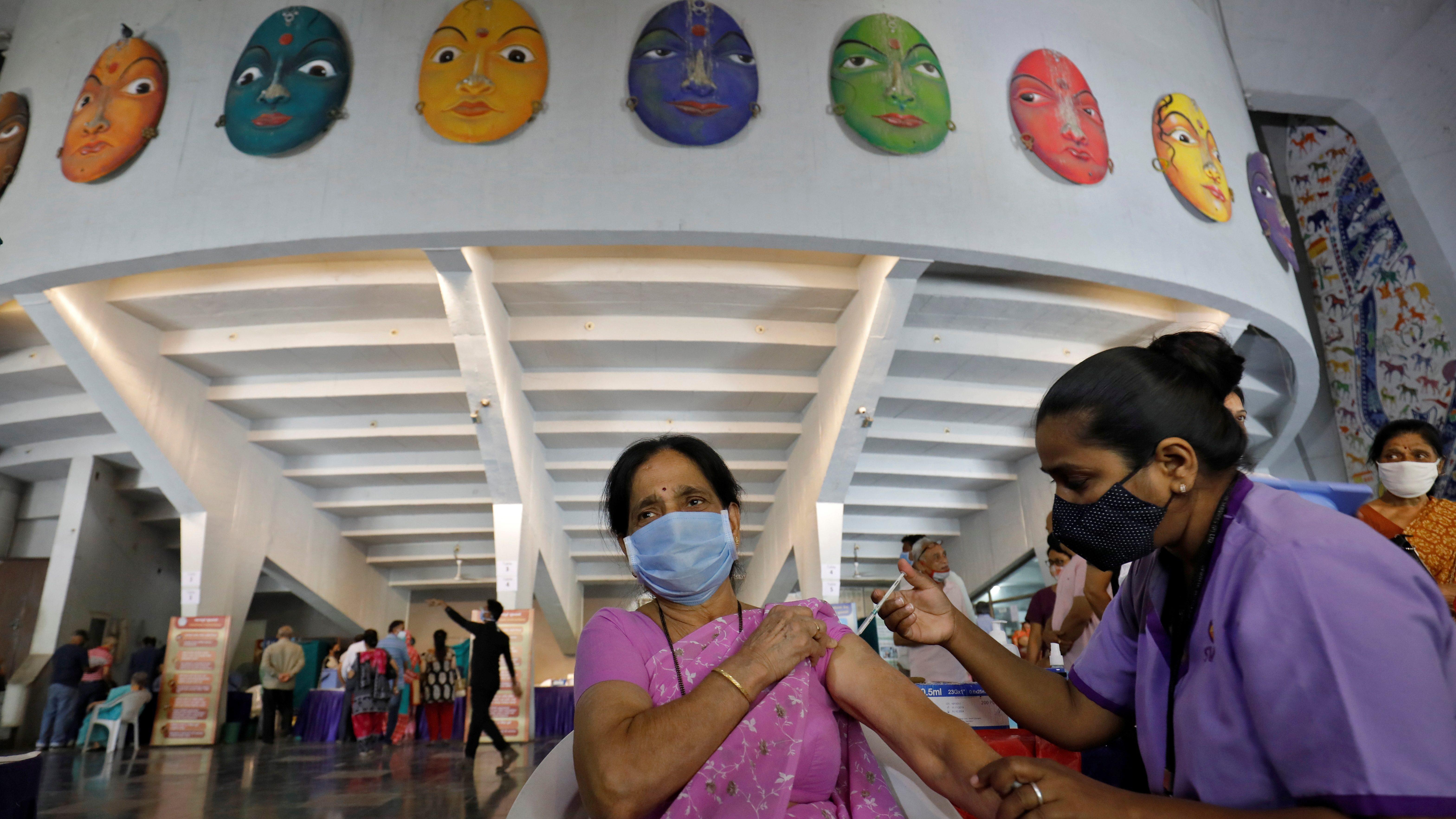 A woman receives a dose of the COVISHIELD coronavirus disease (COVID-19) vaccine, in Ahmedabad