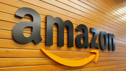 The logo of Amazon is pictured inside a company office