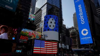 The logo for Coinbase Global Inc, the biggest U.S. cryptocurrency exchange, is displayed on the Nasdaq MarketSite jumbotron and others at Times Square in New York, U.S., April 14, 2021.