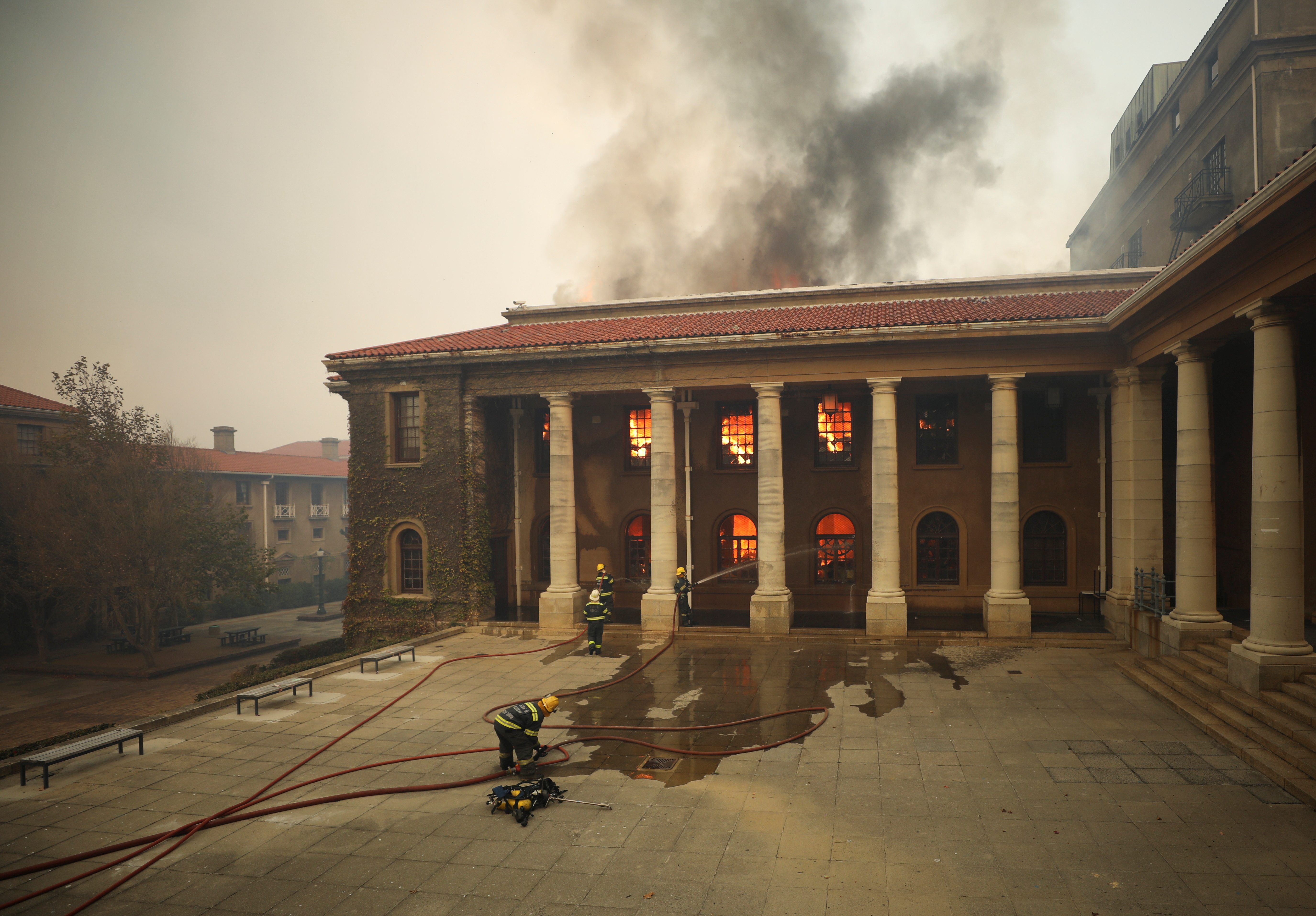 Firefighters battle flames as the library at UCT.