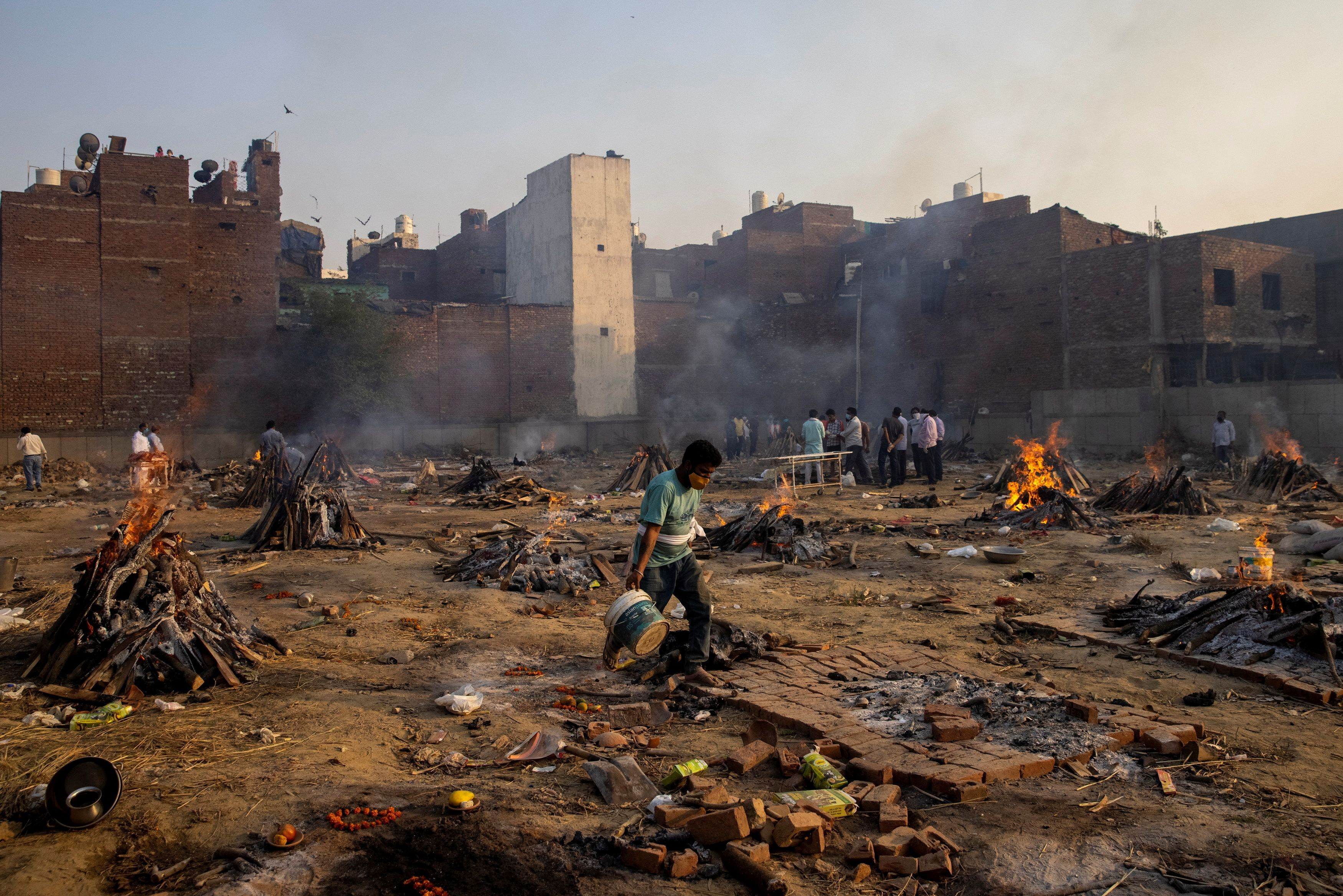 Funeral pyres of people, who died due to the coronavirus disease (COVID-19), are pictured at a crematorium ground in New Delhi