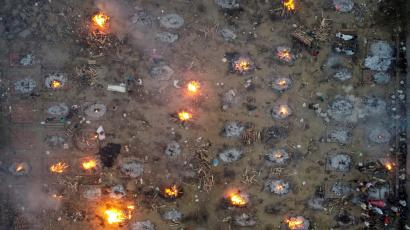 A mass cremation of victims who died due to the coronavirus disease (COVID-19), is seen at a crematorium ground in New Delhi