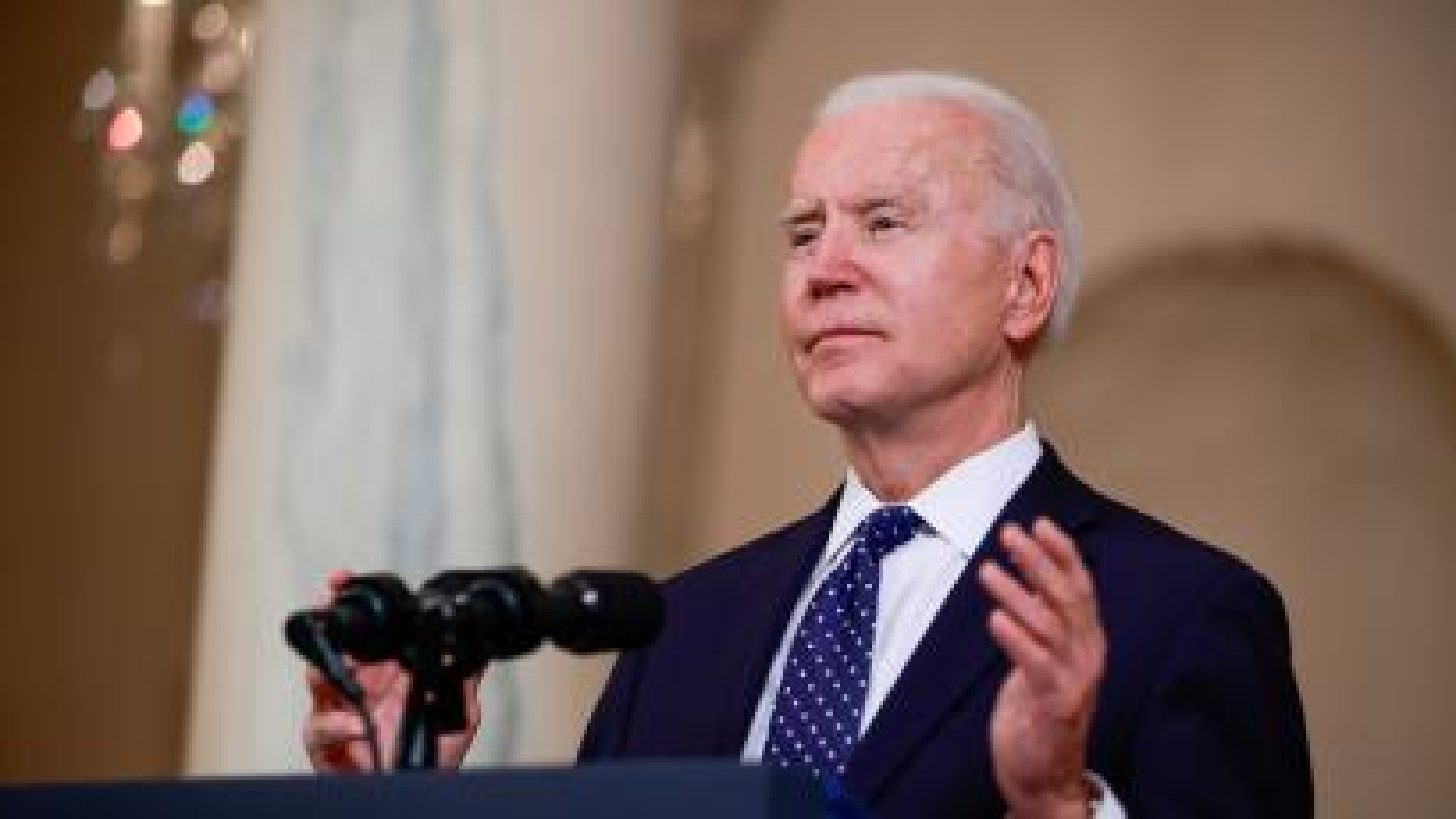 U.S. President Joe Biden speaks in the Cross Hall at the White House in Washington, U.S., April 20, 2021.