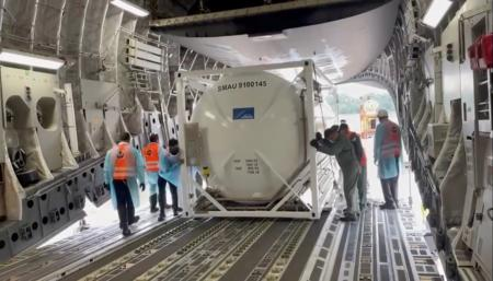 Oxygen tank is loaded into aircraft to supply hospitals in India, at Changi Airport in Singapore