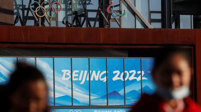 People wearing face masks following the coronavirus disease (COVID-19) outbreak are seen near the office complex of Beijing Organising Committee for the 2022 Olympic and Paralympic Winter Games, a year ahead of the opening of the Games in Beijing, China February 4, 2021.