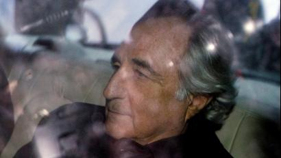 Bernard Madoff is escorted in a vehicle from Federal Court in New York January 5, 2009