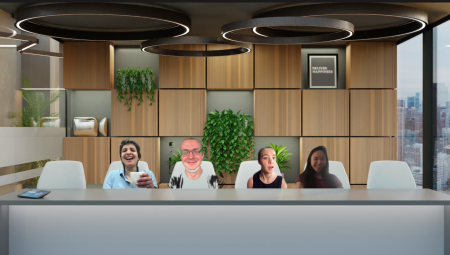 A screenshot of a Zoom call between four Quartz staffers, in which they all appear against one backdrop designed to look like a corporate boardroom. One participant is mostly blurred into the background.