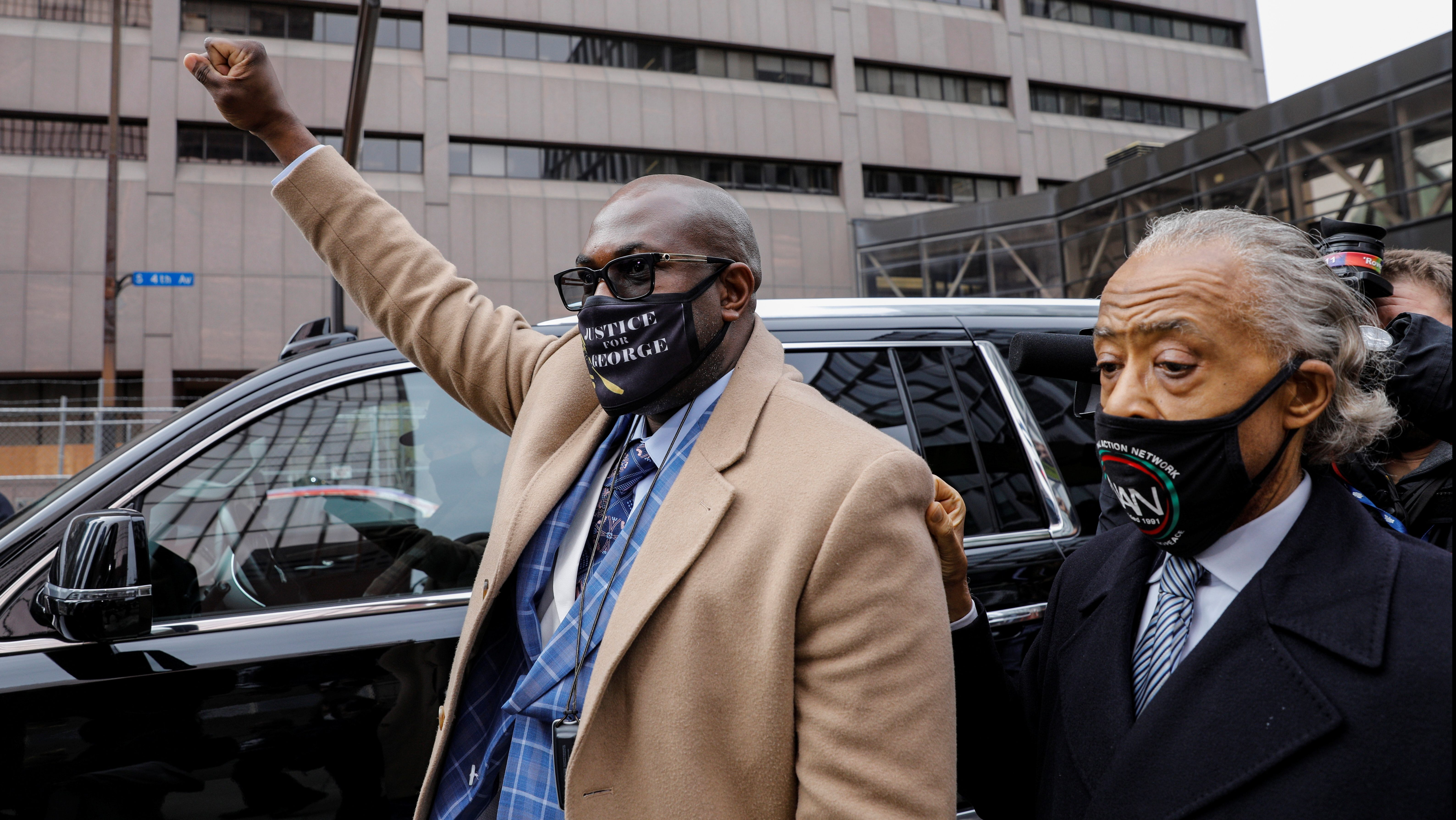 George Floyd's brother Philonise Floyd and Reverend Al Sharpton leave the Hennepin County Government Center on April 19, 2021.