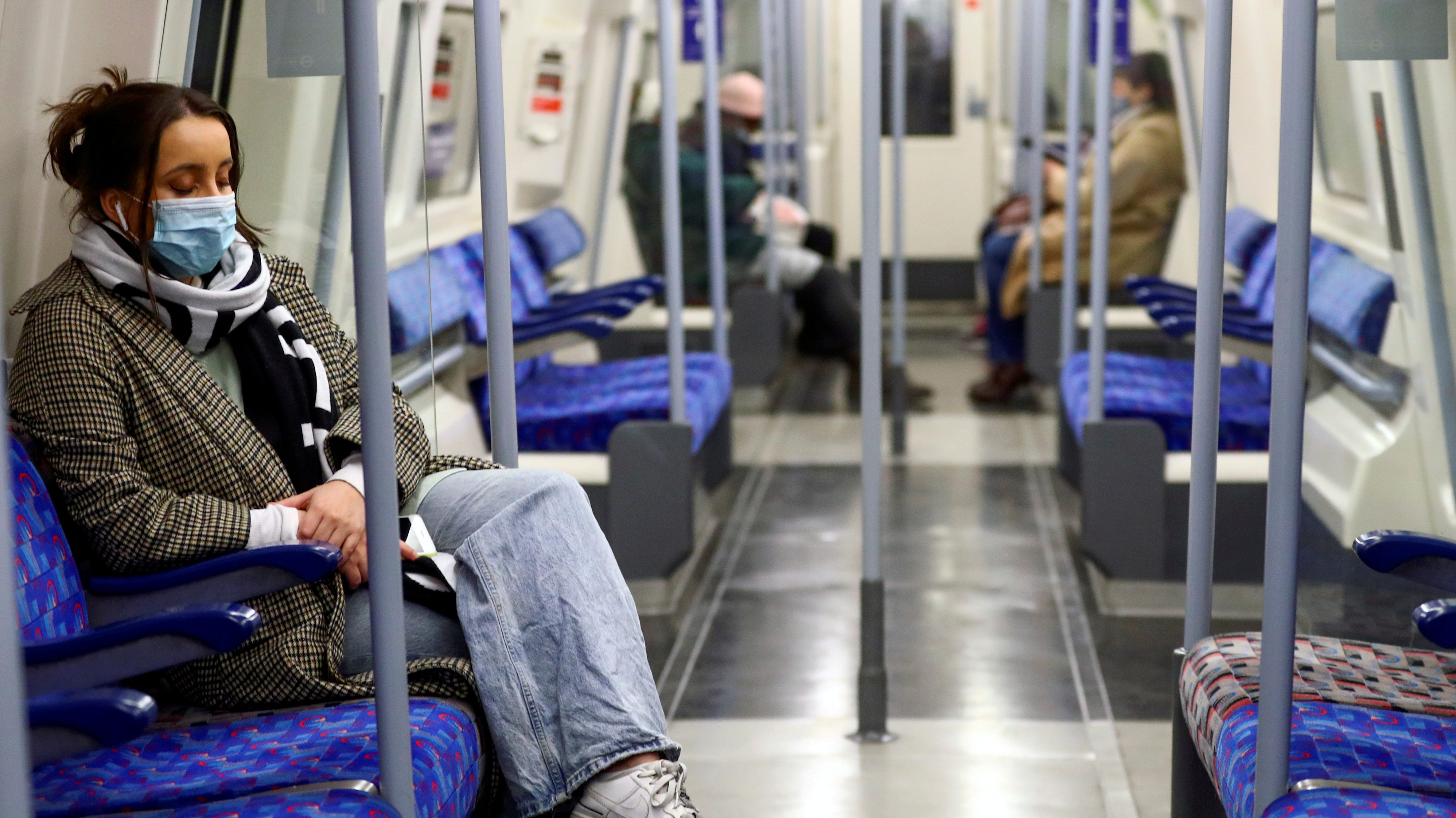 Commuters travel by underground inside an almost empty train, amid the coronavirus disease (COVID-19) outbreak, in London, Britain, January 5, 2021. REUTERS//File Photo